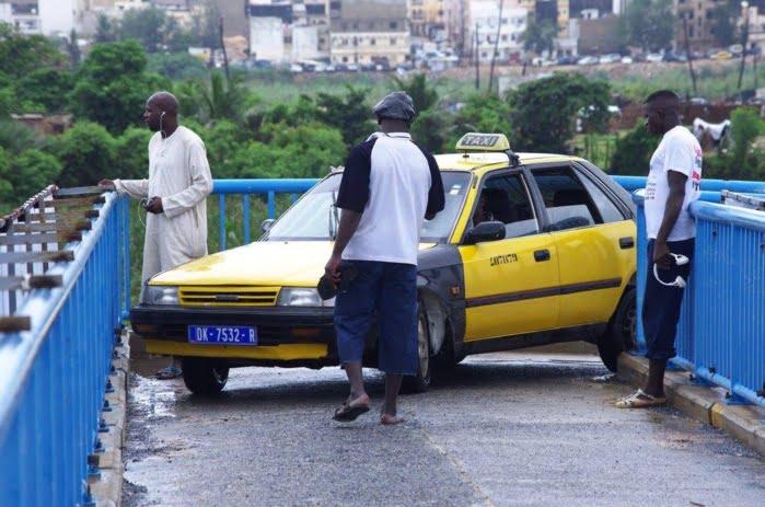 Camberene, Conducteur, Garde des Sceaux, Justice, passerelle, pluie, route, Sanctions, Sénégal, taximens
