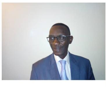 Affaire Petrotim : N'en déplaisent aux mercenaires ! Par David Mboup - Un homme en costume cravate - Des lunettes