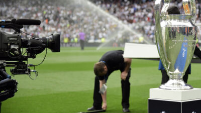 A TV camera takes images of the UEFA Champions League trophy before the UEFA Champions League semifinal first leg football match Real Madrid CF vs Club Atletico de Madrid at the Santiago Bernabeu stadium in Madrid, on May 2, 2017. / AFP PHOTO / JAVIER SORIANO