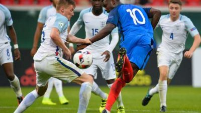 France's forward Marcus Thuram (R) and England's defender Taylor Moore vie for the ball during the UEFA U-19 European Championship group B football match between France and England in Heidenheim, southern Germany, on July 12, 2016.  England won 2-1. / AFP / THOMAS KIENZLE