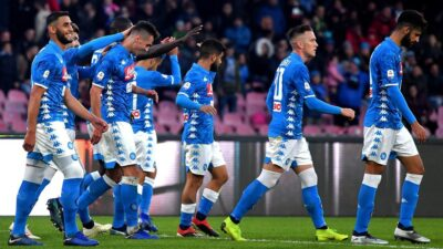 Napoli's players celebrate after scoring during the Italian Serie A football match between Napoli and Frosinone at the San Paolo stadium in Naples on December 8, 2018. (Photo by Tiziana FABI / AFP)